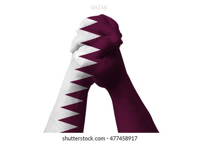 Man clasped hands patterned with the QATAR flag
