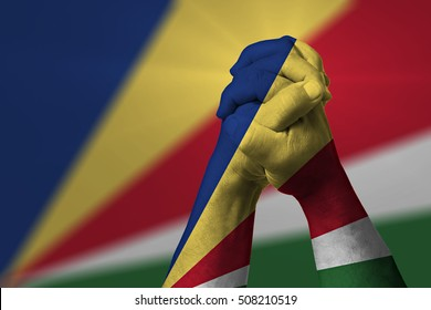 Man clasped hands patterned with the SEYCHELLES flag