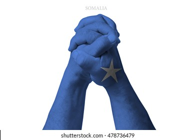 Man clasped hands patterned with the SOMALIA flag