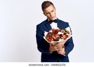 man in a classic suit, a bouquet