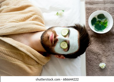 Man with a clay mask