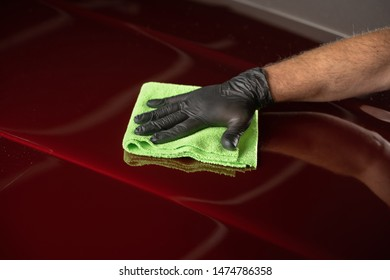 Man cleaning car with microfiber cloth,vintage old car detailing close up