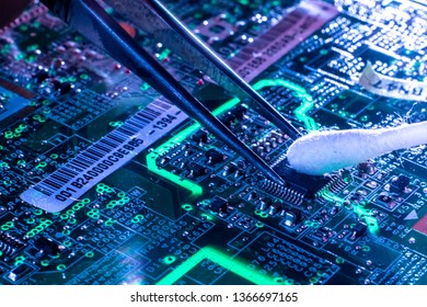 man cleaning dirty electric circuit with cotton stick macro shot of technology concept