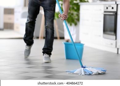 Man cleaning floor indoors