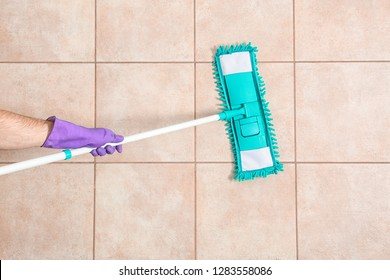 Man cleaning floor with mop, top view