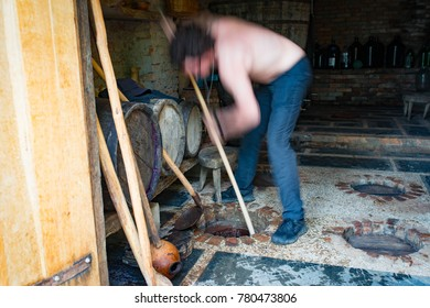 Man is cleaning of the georgian wine kvevri