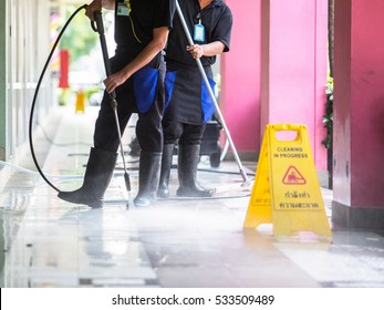 Man cleaning the ground floor