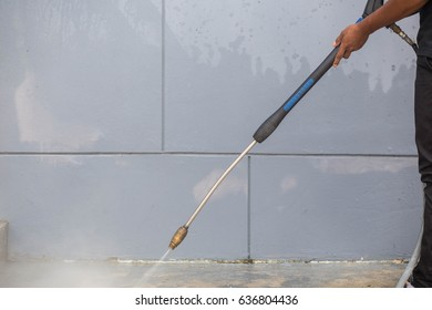 The man cleaning with high pressure water jet.