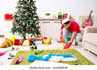 Man cleaning his apartment after christmas party