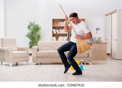 Man cleaning home with broom