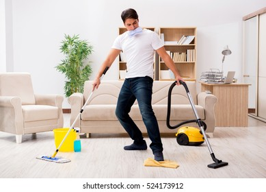 Man cleaning home with vacuum cleaner