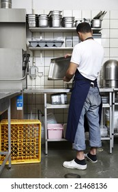 man cleaning kitchen