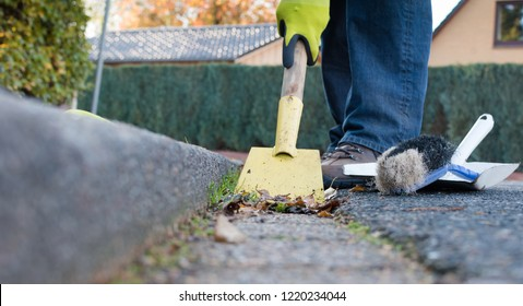 Man is cleaning the street gutter