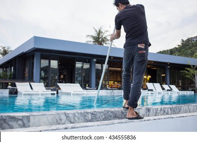 The man cleaning swimming pool.