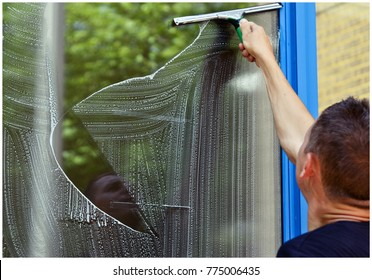 Man cleaning window using Window Cleaning Squeegee, cleaning services