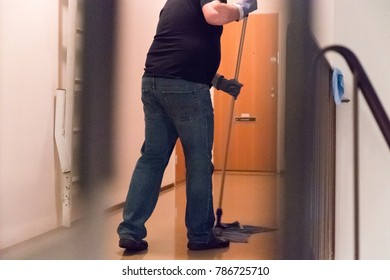 man cleans the floors in the building. horizontal shot
