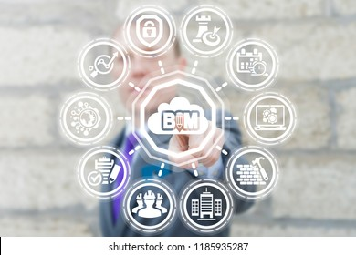 Man clicks a BIM with cloud button on a virtual panel. Building Information Modeling Cloud Computing Designing Construction. Digital Architecture Model Business concept.