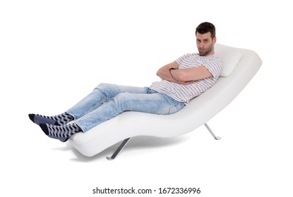Man client sitting with psychologist on the comfortable couch during the psychological session