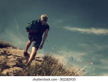 Man climb on mountain hill