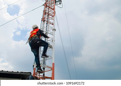 man climb tower to working,technician work high risk location,telecommunication tower.