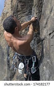 man climbing cliff, italian Alps