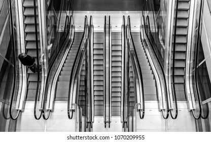 Man climbing up a escalator in a Rotterdam market