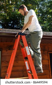 Man climbing ladder to roof for repairs
