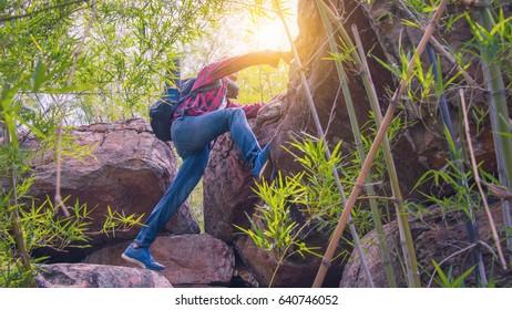 a man  is  climbing the mountain