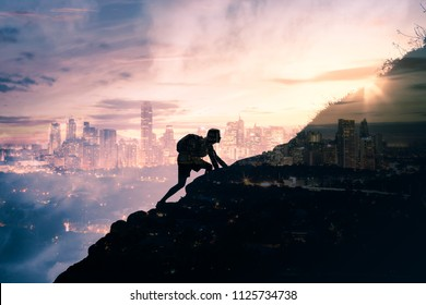 Man climbing up mountain against city background. Reach your life goals and conquer your fears concept. Double exposure.