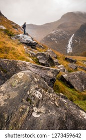 Man climbing mountains shallow depth of field during sunset in Autumn on the Isle of Skye, Scotland, UK.