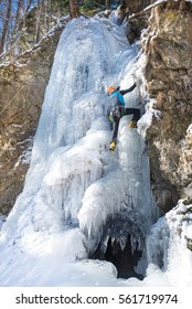 Man climbing on frozen waterfall I