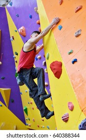 Man Climbing Up On Practice Wall Indoor