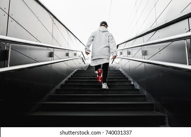 man climbs the stairs. Urban wallpaper. Interior poster. Hype sneaker. Background