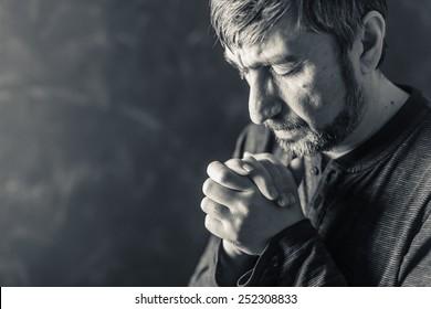 man closed his eyes to pray