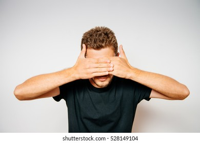 Man closes eyes with her hands