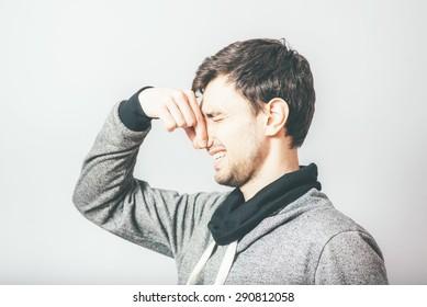 man closes his nose stinks
