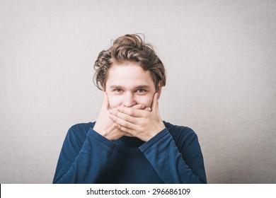 man closes mouth