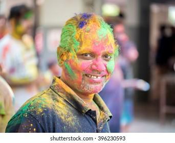 Man closeup on Indian color festival called HOLI, Mumbai, Maharashtra, India, Southeast Asia.