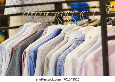 man clothes multi color  on hangers in park outdoor Thailand