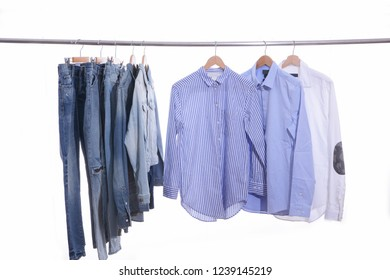 man clothes with stripy ,shirts ,jacket jeans ,blue jeans on hanger