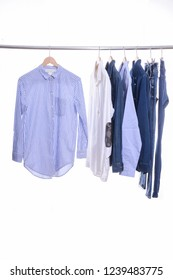 man clothes with stripy ,shirts ,jacket jeans on the rack clothing