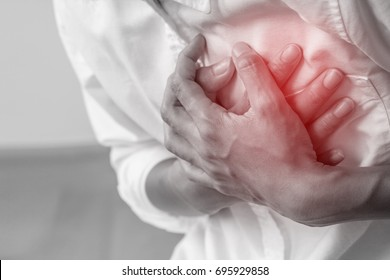 Man clutching his chest from acute pain.Heart attack symptom-Healthcare and medical concept.