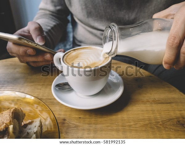 Man in the coffee shop business.