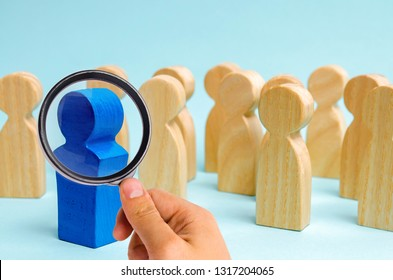 A man comes out of the crowd. Business team. Attracting people to work. Human Resource Management. The dismissal of staff. Promotion and demotion. Hiring. Concept of business leader, boss. Hrm, Hrd.