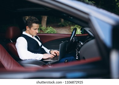 Man with computer in car