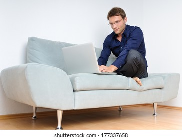 Man with computer on the sofa