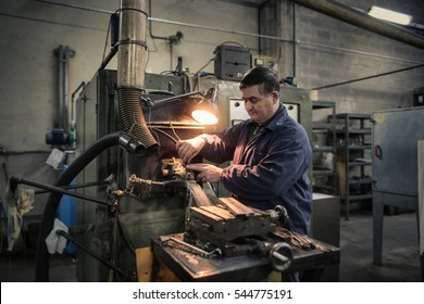 Man concentrating on his work at the factory