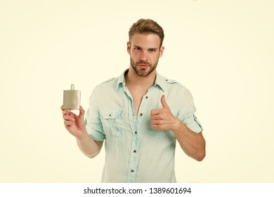 Man confident face recommend perfume shows thumb up gesture. Guy with bristle bottle perfume he likes this fragrance. Male fragrance concept. Man handsome recommend pleasant aroma for male.