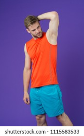 Man confident in his antiperspirant. Guy checks dry armpit satisfied with healthy skin. Prevent, reduce perspiration. No sweat - deodorant works. Sportsman after training pleased with antiperspirant.