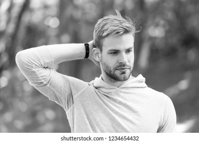 Man confident in his antiperspirant. Guy checks dry armpit satisfied with clean clothes. Sportsman after training pleased with antiperspirant. Prevent, reduce perspiration. No sweat - deodorant works.